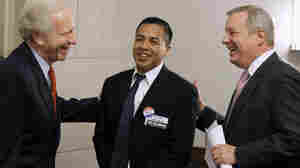 Sens. Richard Durbin and Joseph Lieberman with Cesar Vargas.
