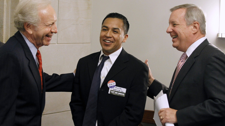 Sens. Joseph Lieberman of Connecticut (left) and Richard Durbin of Illinois (right) talk with Cesar Vargas, a law student from New York City, on Capitol Hill in September. Vargas is one of some 2 million young people who would qualify for legal residency under the DREAM Act. (AP)