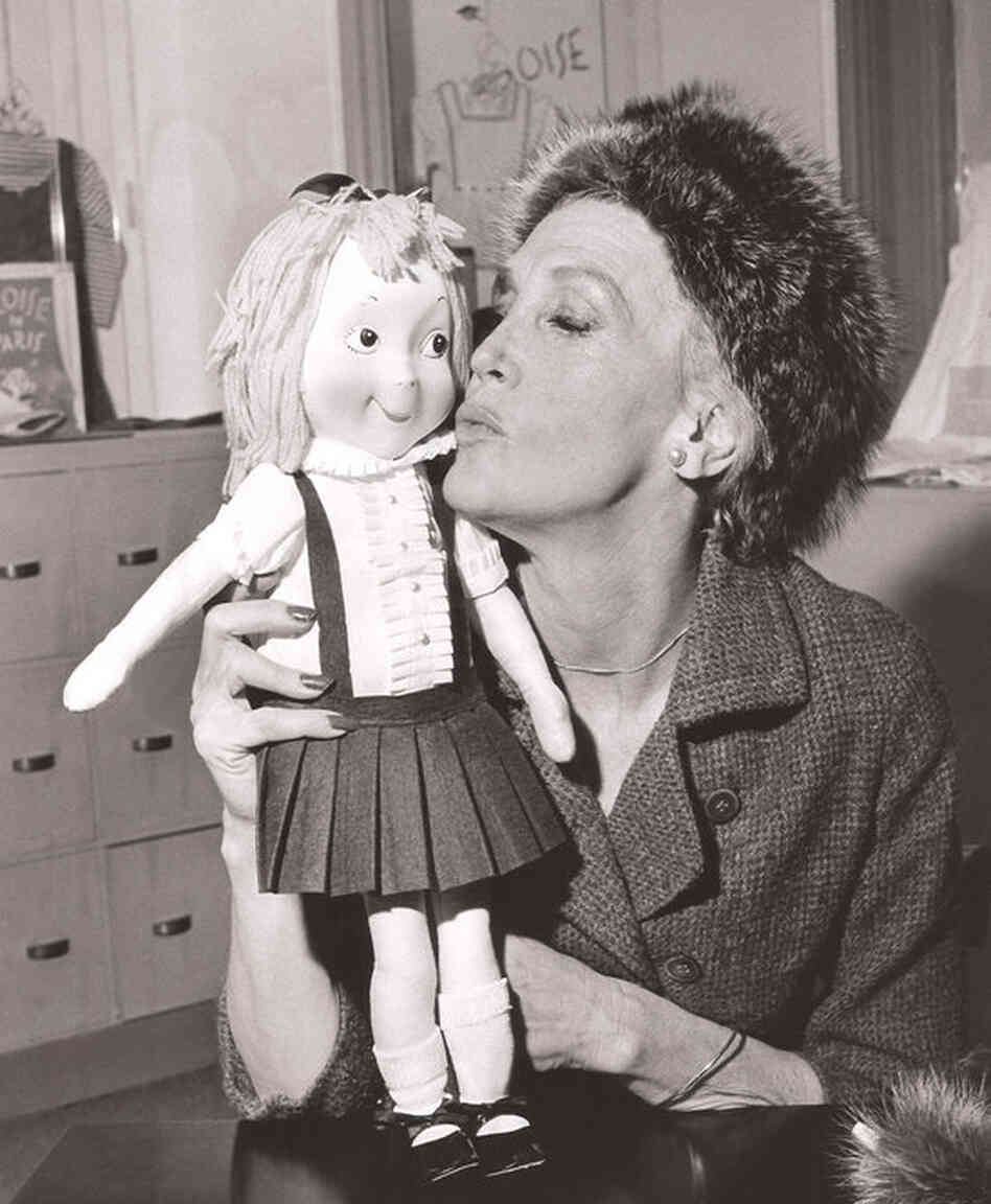 Kay Thompson, author of the Eloise children's books, holds an Eloise doll in 1957.