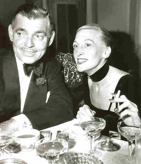 Clark Gable and Thompson celebrate her million-dollar nightclub deal to appear at Arnold Kirkeby's hotels in 1948.