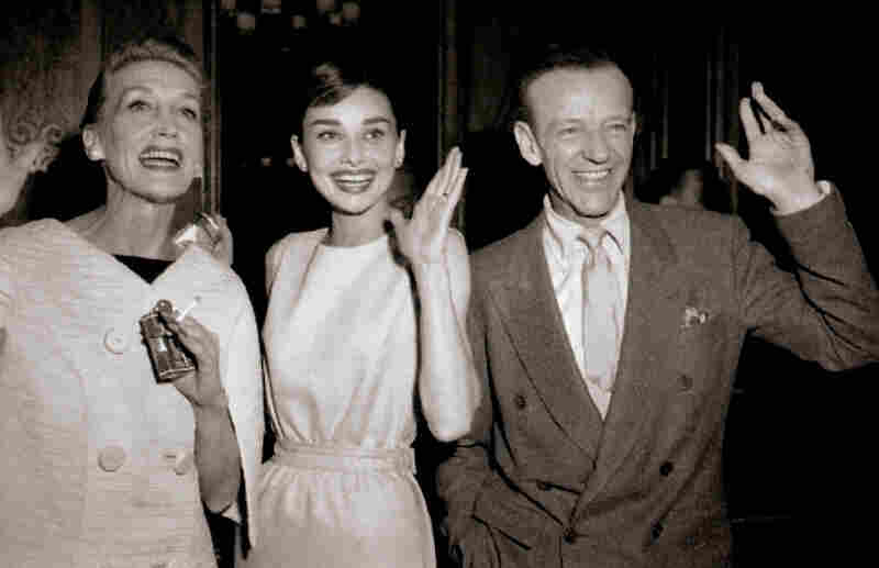 Thompson, Audrey Hepburn and Fred Astaire arrive in Paris for location filming of Funny Face in June 1956.