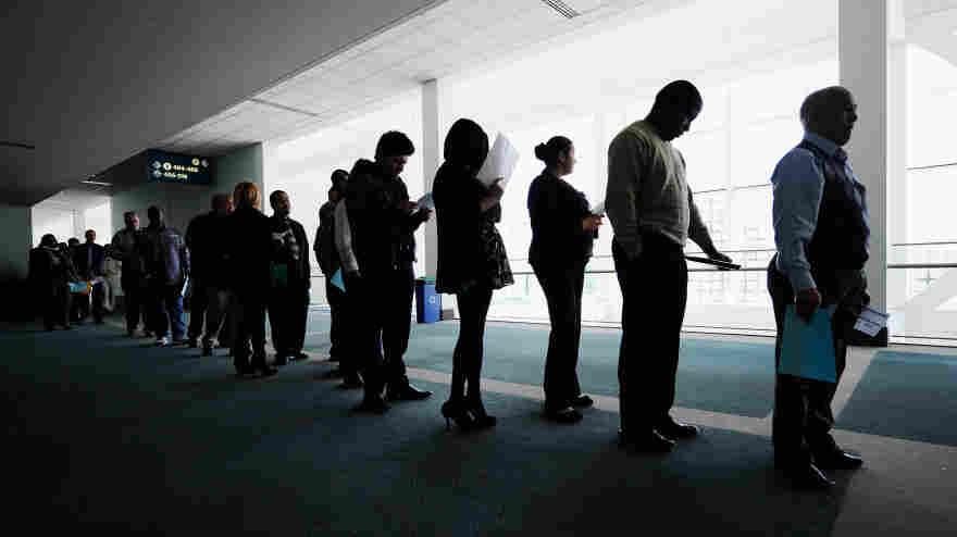 Jobseekers line up to enter a career fair