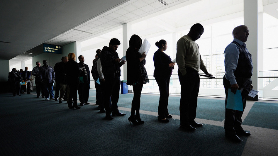 Jobseekers line up to enter a career fair in Los Angeles. Last month, the nation's unemployed totaled 15.1 million.
