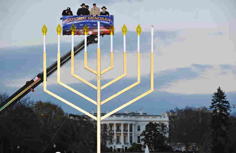 Rabbi Levi Shemtov, Washington director of the American Friends of Lubavitch; White House Budget Director Jack Lew; and Rabbi Abraham Shemtov, director of the American Friends of Lubavitch, take part in the annual Hanukkah menorah lighting ceremony at the White House on Wednesday.