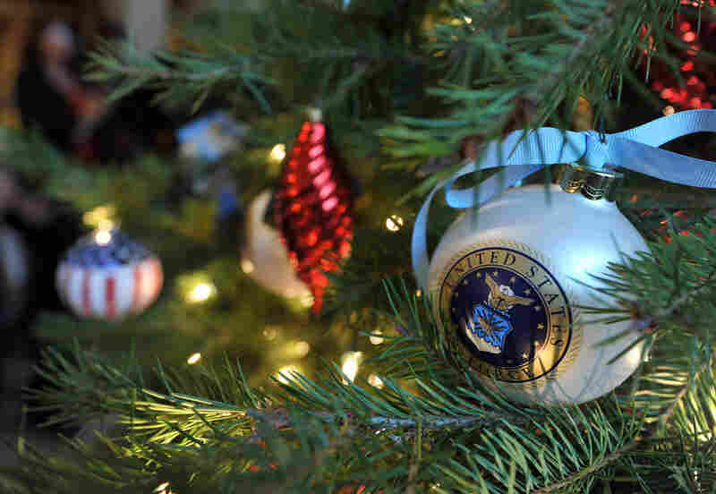An ornament hangs on a Christmas tree at the White House.