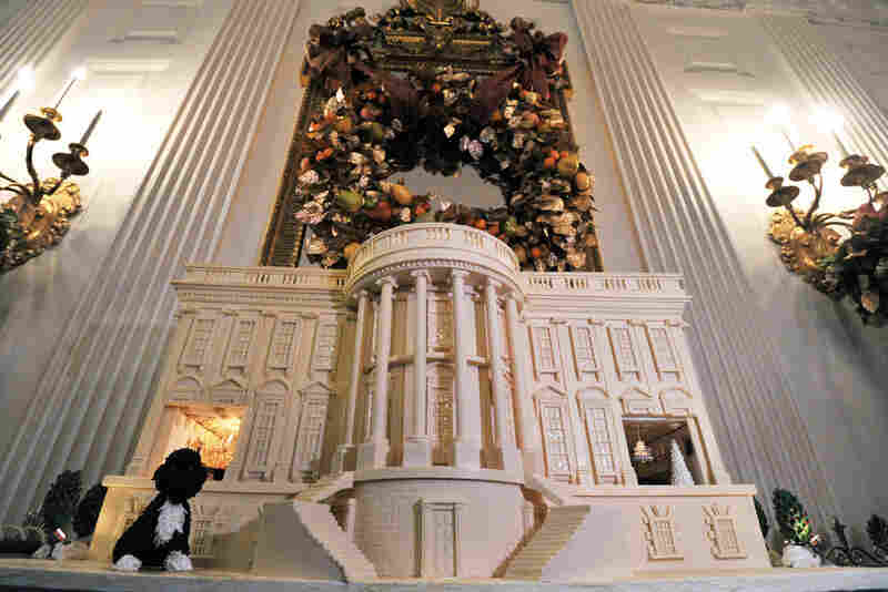 A replica of the White House made out of chocolate and gingerbread.