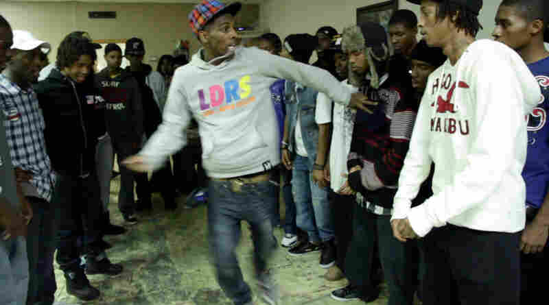 """A dancer from the group """"Leaders Of The New School"""" battles in the center of the circle."""