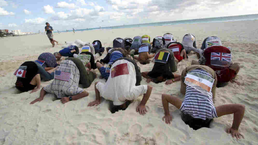 Activists on the beach in Cancun.