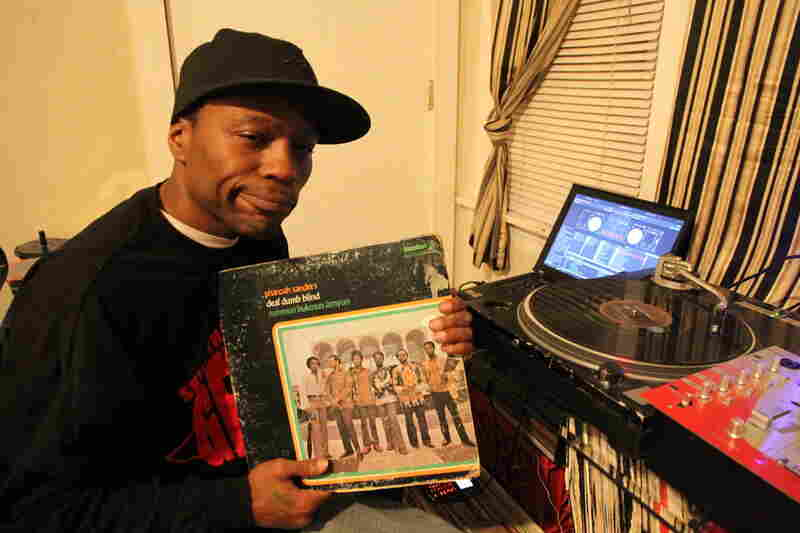 Traxman holding a record of Pharoah Sanders.