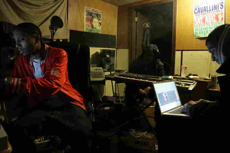 "(From left) DJ Spinn, DJ Rashad, and Gant-Man work on a track at their studio ""The Tracks Factory""."