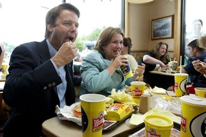 "Edwards shares a 27th anniversary lunch with her husband John at a Wendy's restaurant in Newburgh, NY, during the 2004 ""Believe in America"" bus and train tour. Each year, the couple returned to Wendy's on their anniversary to remember their early days together."