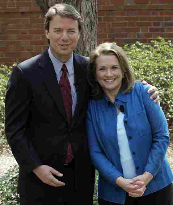 Democratic presidential hopeful John Edwards hugs his wife Elizabeth while they speak about her recurrence of cancer during a news conference in Chapel Hill, N.C., in March 2007.