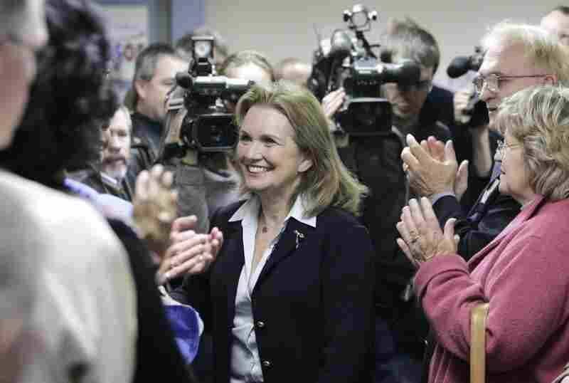 "Edwards is greeted by supporters before speaking at the official opening of the ""Edwards for President"" campaign headquarters in Des Moines on April 12, 2007."
