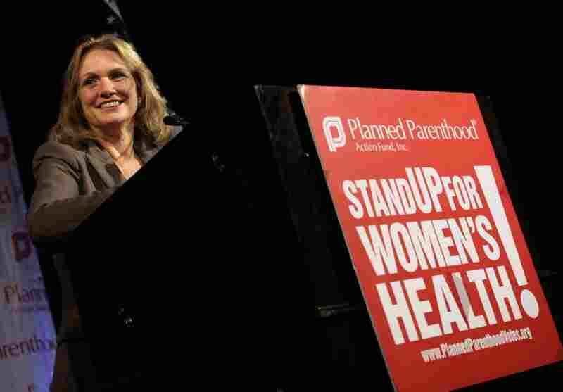 Edwards smiles during a speech at the Planned Parenthood Action Fund conference in Washington, on July, 17, 2007.