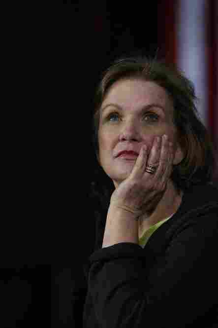 """""""Resilience is accepting your new reality, even if it's less good than the one you had before,"""" said Edwards. Here, she watches her husband speak to voters at a town hall style meeting in Davenport, Iowa, in December 2007."""
