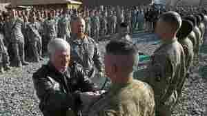 Defense Secretary Robert Gates bestows awards to soldiers in Kunar province on Tuesday.