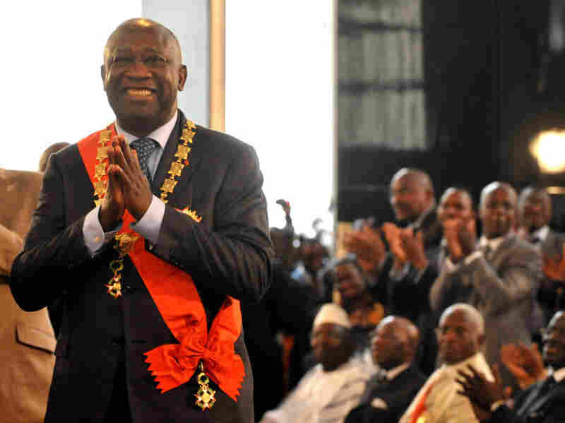 Laurent Gbagbo smiles after being formally sworn in as Ivory Coast's president