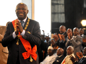 Laurent Gbagbo smiles after being formally sworn in as Ivory Coast's president during a ceremony on Dec. 4, 2010, in Abidjan. The ceremony came despite international rejection of his the incumbent's disputed presidential re-election victory.