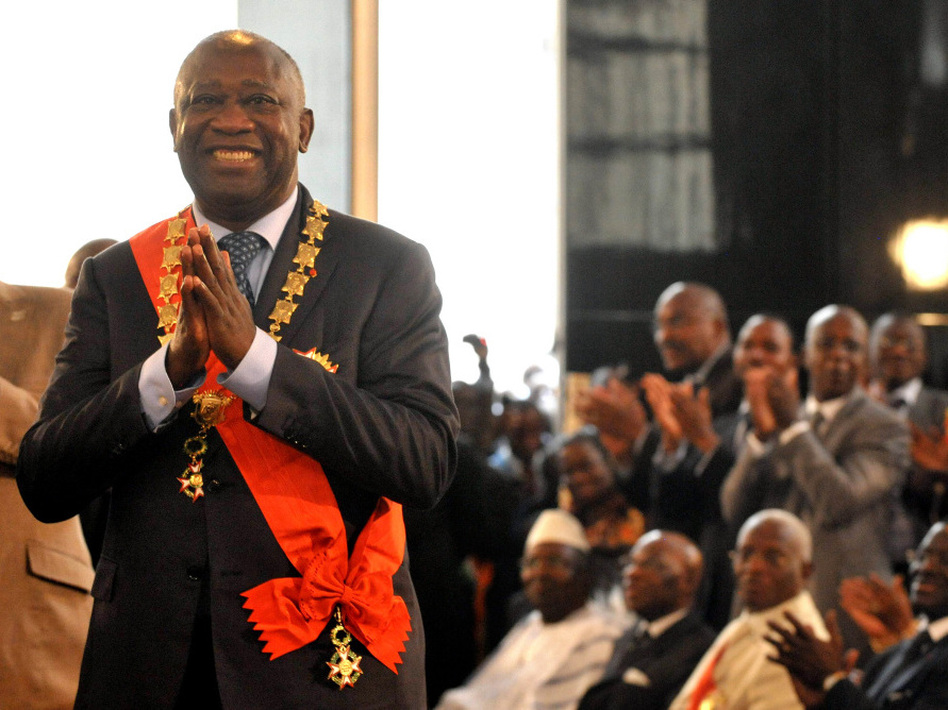 Laurent Gbagbo smiles after being formally sworn in as Ivory Coast's president during a ceremony on Dec. 4, 2010, in Abidjan. The ceremony came despite international rejection of his the incumbent's disputed presidential re-election victory. (AFP/Getty Images)