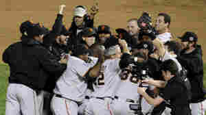 The San Francisco Giants celebrate after Game 5 of baseball's World Series against the Texas Rangers