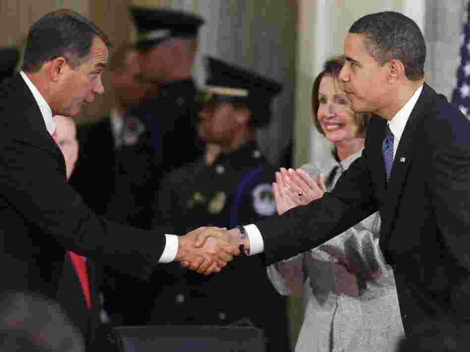 President Obama shakes hands with House Republican Leader John Boehner (R-OH).
