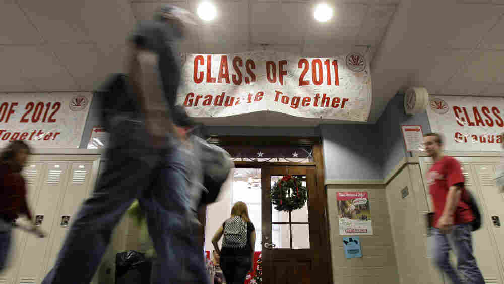 Students walk past a banner between classes at Richmond High School in Richmond, Ind., on Nov. 29.