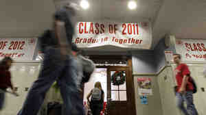 Students walk past a banner between classes a