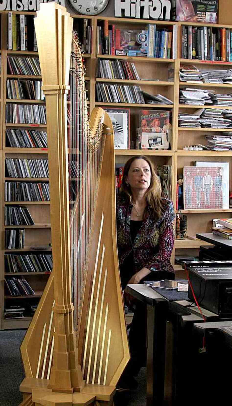 Yolanda Kondonassis next to her Art Deco-inspired harp at NPR.