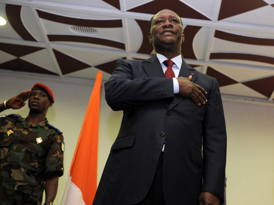 Alassane Dramane Ouattara sings the national anthem during a ceremony in a hotel in Abidjan, Dec. 4, 2010, during which he appointed a new prime minister. Opposition leader Ouattara swore himself in as Ivory Coast's new president Dec. 4, laying claim to the presidency in defiance of Gbagbo, who faces international pressure to step aside. (AFP/Getty Images)
