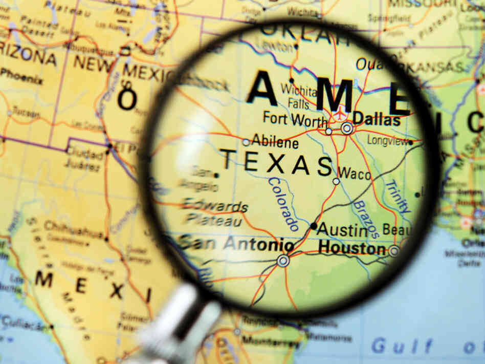 A magnifying glass zeroes in on Texas.