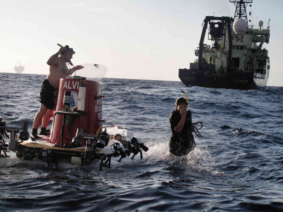 Once the deep-sea sub is in the water, swimmers Jerry Graham (left) and Kami Bucholz make final preparations for a dive. Alvin has made more than 4,600 dives around the world.