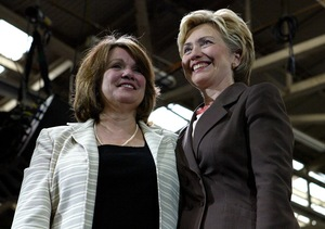 Edwards stands with Sen. Hillary Clinton during a Kerry/Edwards breakfast reception in New York in 2004.