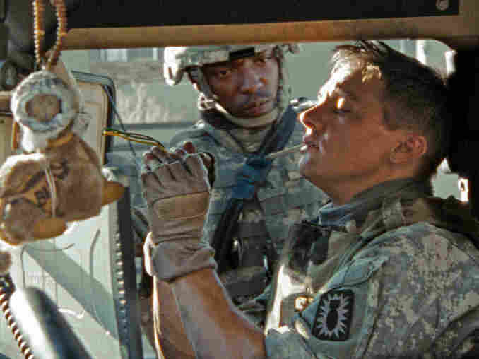 Anthony Mackie and Jeremy Renner in the cab of a military vehicle