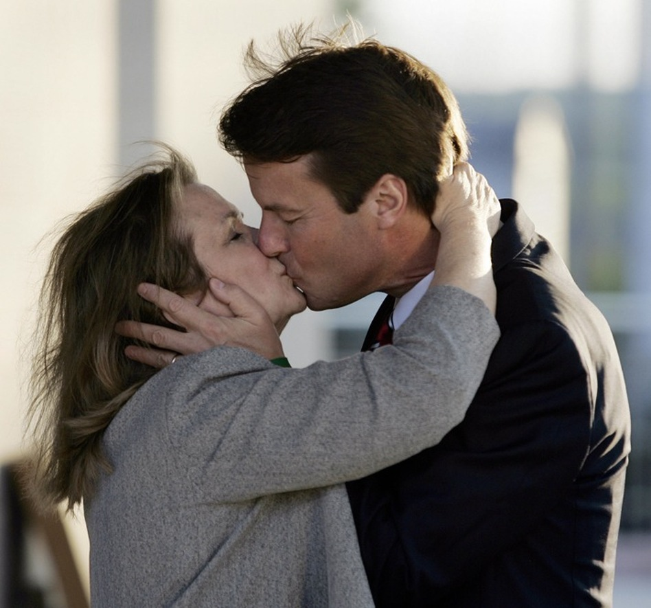 John and Elizabeth met as law students at the University of North Carolina at Chapel Hill. Here, John kisses her good-bye as she departs for a fund-raiser for the South Carolina Democratic Party in Columbia, S.C. in 2007.  (AFP/Getty Images)