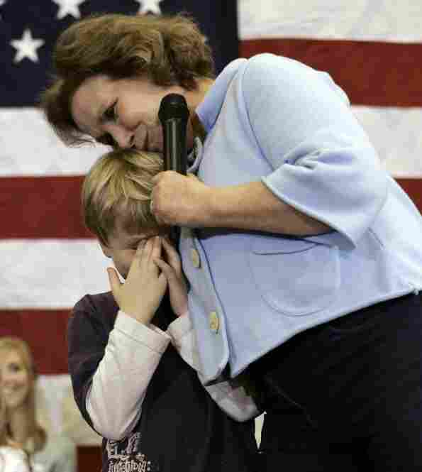 Edwards hugs son Jack onstage after he was too embarrassed to talk in Ames, Iowa, Jan. 1, 2008.