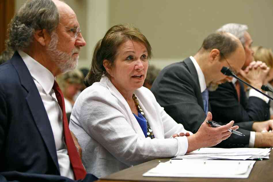 New Jersey Gov. Jon Corzine and Edwards talk before testifying in Washington, D.C., about health care reform, Sept. 18, 2008.