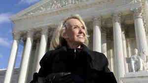 Arizona Gov. Jan Brewer stands outside the Supreme Court.