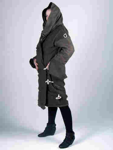A model wears the Elements S[urvival] coat, which can transform from a winter coat to a sleeping bag