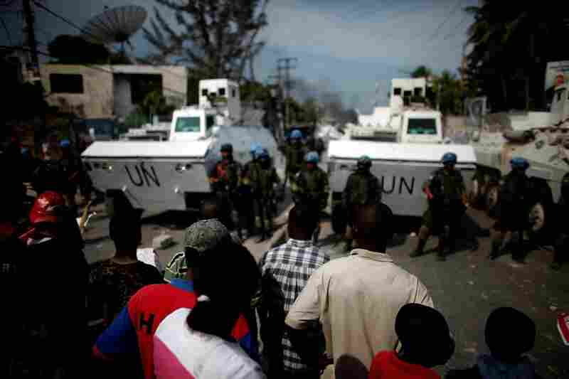Martelly supporters confront Brazilian U.N. soldiers in Port-au Prince.