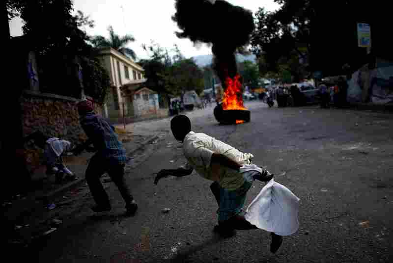 Protestors block the road in Petionville, a suburb of Port-au-Prince. Thousands of protesters demonstrated across Haiti on Wednesday over what they claim are rigged results of the Nov. 28 presidential election.