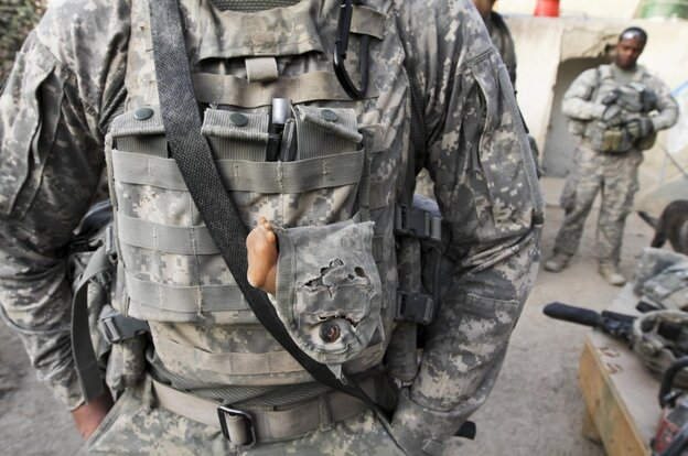 "Pvt. 1st Class Edwin Laplaunt carries a ""lucky doll's foot"" in Afghanistan"