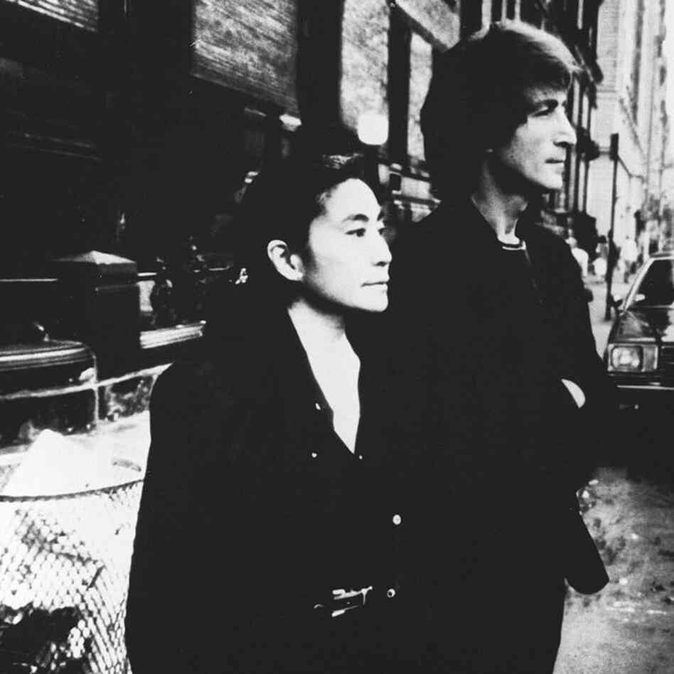 John Lennon (R) and Yoko Ono outside the Dakota Apartments on Nov. 12, 1980.