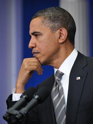 Obama listens to reporter