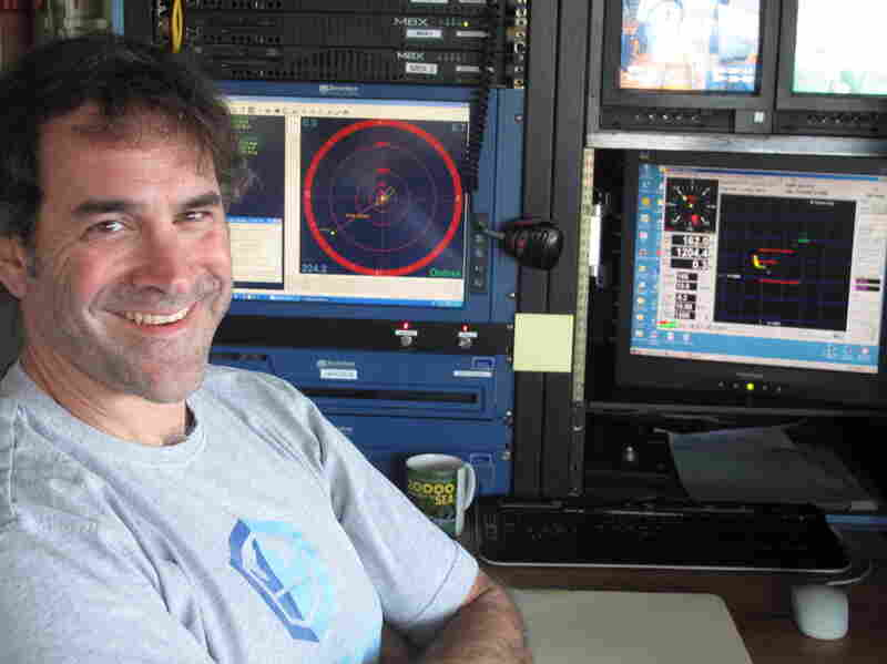 Bruce Strickrott is in charge of Alvin's operations. Here, he monitors a dive from Alvin's control center aboard Atlantis.