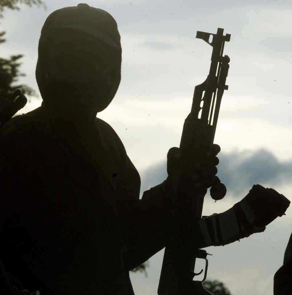 A rebel soldier holds an AK-47 assault rifle.