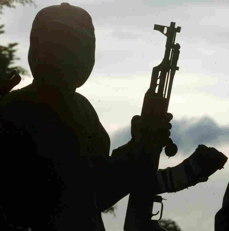 A rebel soldier holds an AK-47 assault rifle.