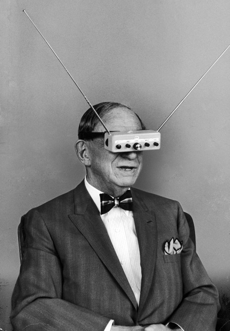 "Inventor Hugo Gernsback demonstrates ""TV Glasses"" for television on the go. Take that, iPhone."
