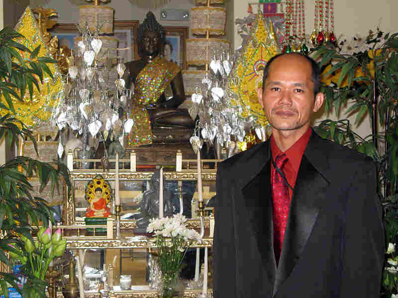 Van Suon stands in front of the shrine at the Buddhist Temple
