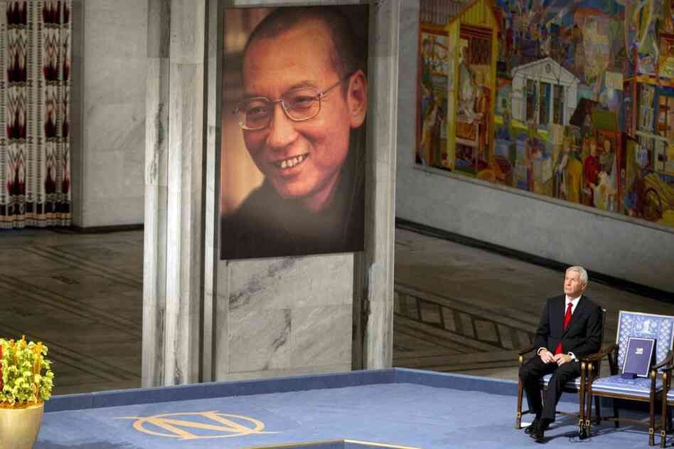 Nobel Peace Prize committee Chairman Thorbjorn Jagland sits next to the empty chair representing Nobel Peace Prize laureate Liu Xiaobo.