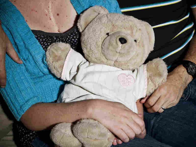 "Jeni Busta holds her ""Heart Bear,"" which she was given when she was born."